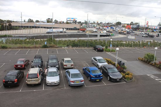 Fawkner, Australia: View of car park and M80 Freeway onramp. Maccas/Coles/Kmart is just in the background.