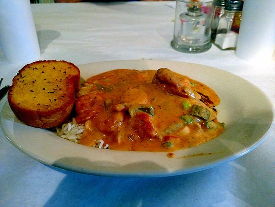 Foley, AL: Good cajun creole sauce tops tilapia, shrimp on a bed of rice. Not overly rich, and spiced mildl