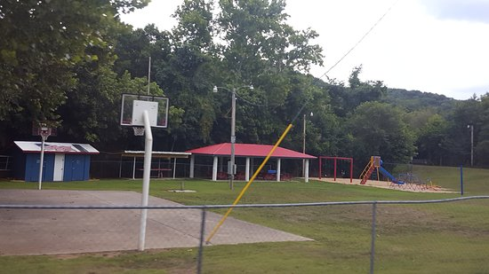 Galena, MO: This is a view of the park basketball court and play area.