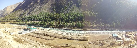 Sangla, India: Chhitkul Government School at the left corner and riverside camp site at the right corner