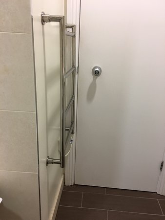 Thistle Holborn, The Kingsley: The towel rail in room 221 that close to the door when towels on it the door doesn't close and w