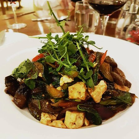 Creaton, UK: Marinated tofu stir fried with vegetables and grilled asparagus