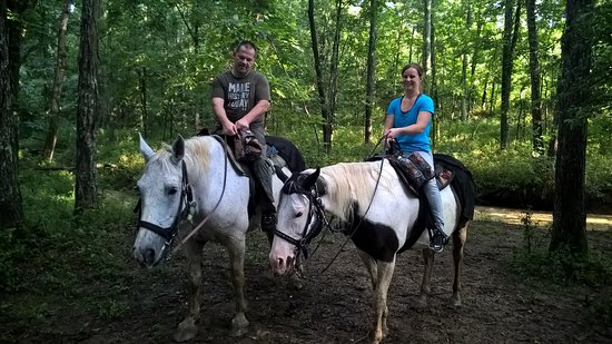 """Whispering Woods Riding Stable: """"Poppy"""" on the left and """"Dealer"""" on the right taking a water break on the trail"""