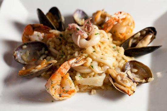 Zingari Ristorante + Jazz Bar: saffron scented risotto, prawns, scallops, calamari, crustacean fumé