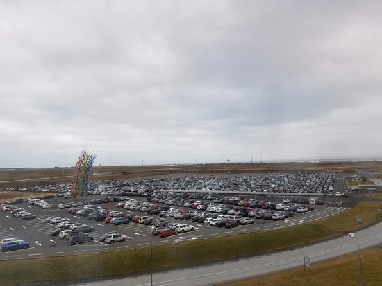 Airport Hotel Aurora Star: View of the airport parking lot and vast tundra beyond.