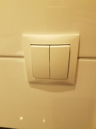 "Airport Hotel Aurora Star: European light switches, down is ""on""."