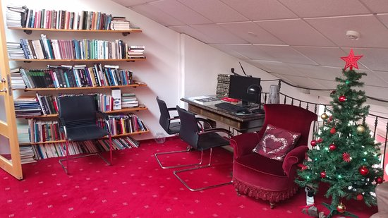 Akranes, Island: upstairs library (one section of two). More books downstairs.