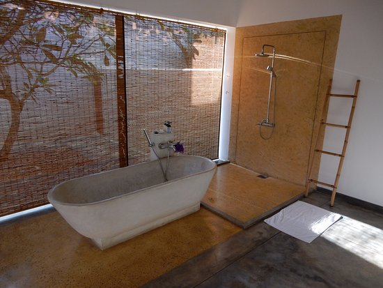 Frangipani Tree: Bathroom set-up for night with shades, which are raised during the day.