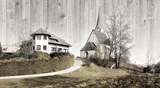 Reifnitz, Áustria: Das Wirtshaus neben der Kirche