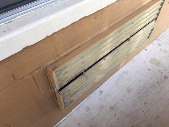 Econo Lodge Biltmore: air conditioner vent outside of room