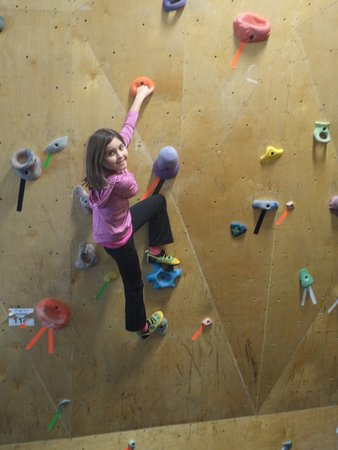 Helena, MT: Our nine-year old having a blast on the climbing wall.