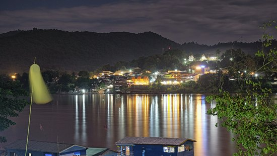 Chiang Khong, Thailand: Night time view looking across the Mekong to Laos
