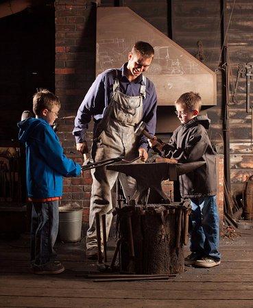 Sherwood Park, Canada: Costumed role-player inside the Demchuk Blacksmith Shop.