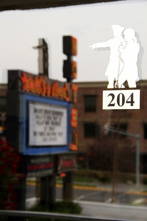 The Lewis & Clark Motel of Bozeman: Our Historic Neon Sign Reflected in our Unique Sliding Glass Entry Door