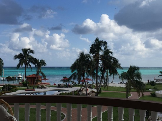 Grand Caribe Belize Resort and Condominiums: A large pool with swim up bar is just to the right of this photo