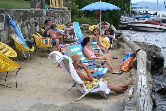 Candlelight Cottages LLC on Lake George : Our sandy beach area overlooking the swimming area