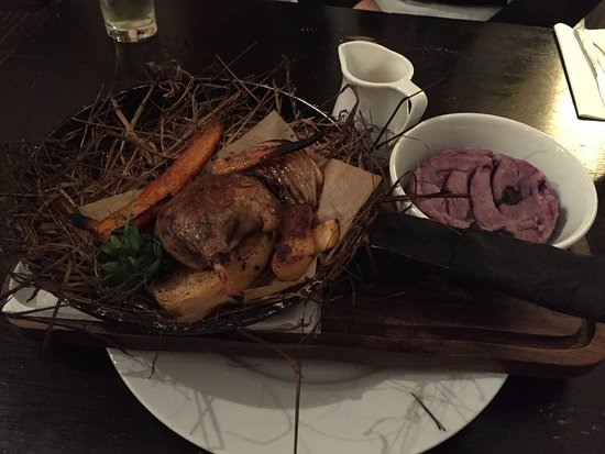 Castle Acre, UK: Served in a pan with roast veg, on a bed of hay.