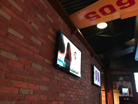 Rouyn-Noranda, Canada : 8 TVs in the bar area. Probably tuned to the Montreal hockey game.