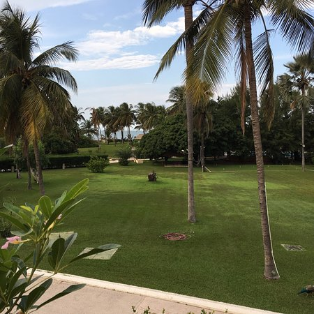 Kairaba Beach Hotel: These are taken from the garden terrace and the reception facing out towards the driveway into t