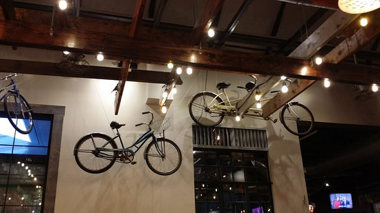 Bikes on the wall ad to the Beach decor - Picture of Crooked Hammock ...