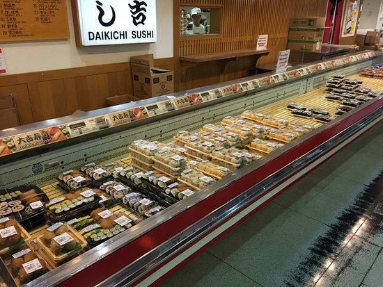 Arlington Heights, IL: The sushi counter. You grab what you want, and pay at the casher, who wil give you the soy sauce