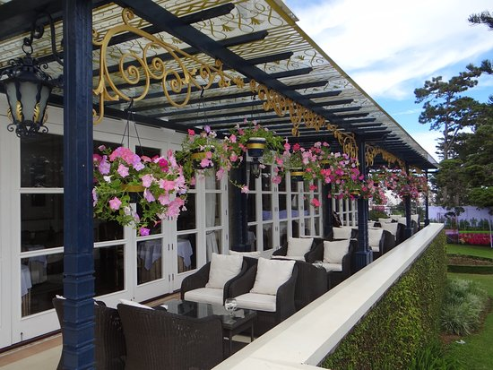 Dalat Palace Heritage Hotel: Relax on the porch with great views all around.