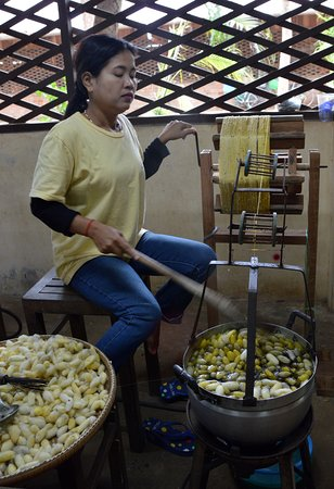Angkor Silk Farm : Raw silk is being spun by hand. You can also view the machines that spin the silk.