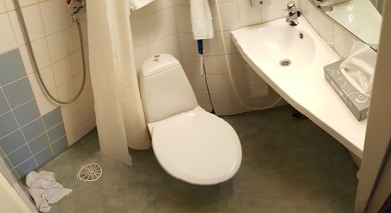 Vantaa, Finland: Panarama of bathroom showing shower, toilet and sink