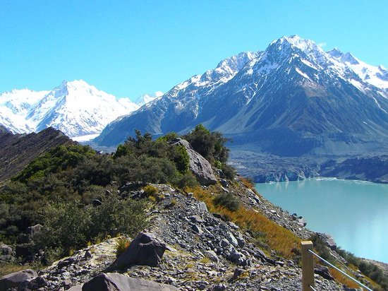 Mt. Cook Village, New Zealand: View of Tasman Glacier at end of lake. More can be seen between the mountain