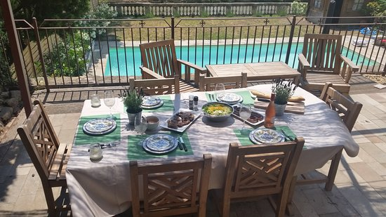 dine al fresco overlooking the salt water pool and canal du midi