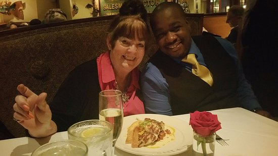 Here is Mom with our wonderful waiter at GW Fins in August 2016...Superb food and service! :)