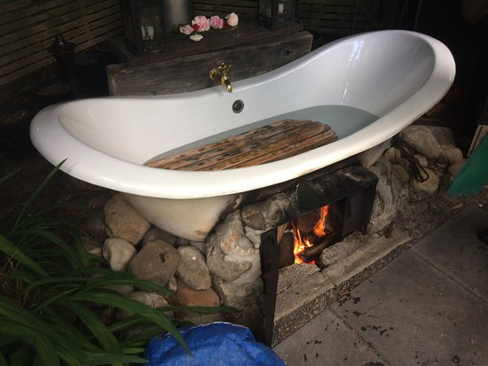 Outdoor bath heated with fire underneath jan lights the fire about warm earth cottage outdoor bath heated with fire underneath jan lights the fire about aloadofball Gallery