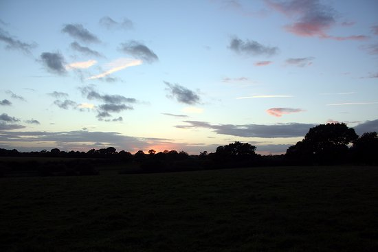 Horsham, UK: The evening sky over Knepp Estate.