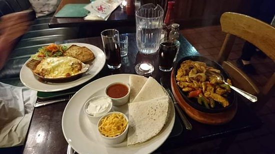 the red lion inn chicken and bacon lasagne alongside sizzling chicken fajitas