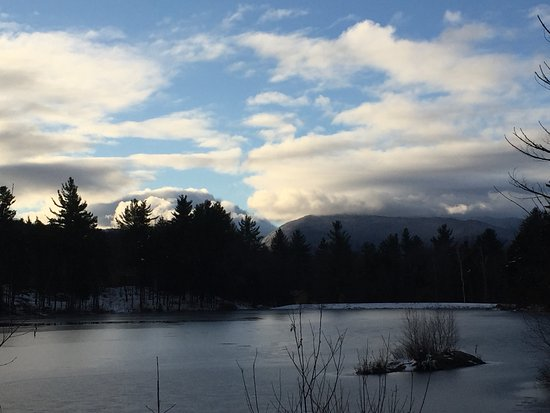 Jeffersonville, VT: The larger pond on the property with Mt. Mansfield in the clouds.
