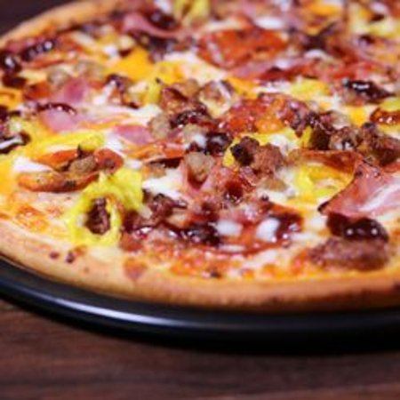Coshocton, OH: Voodoo Pizza loaded with premium meats with drizzles of bbq and ranch sauce