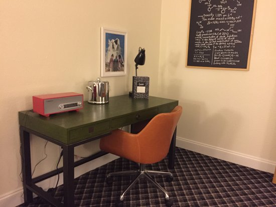 Atenas, GA: Desk in corner of room with retro radio, chair, and chalkboard
