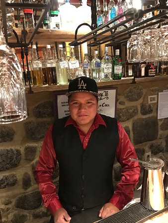 Hotel Arqueologo Exclusive Selection: Best Bartender In Town Who Makes The Best Pisco Sour! Had to give him my LA hat!