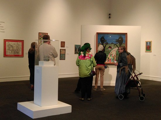 Albany, GA: Visitors enjoy discussion and learning about the exhibit from curator Katie Dillard.