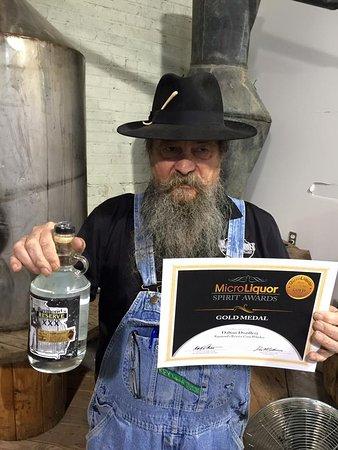 Dalton, GA: Master Distiller Raymond Butler showing his award winning Moonshine