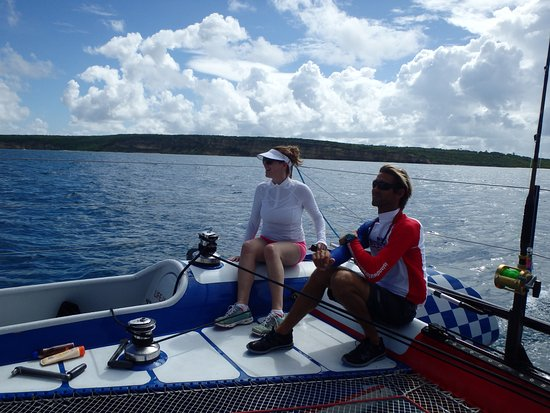 Simpson Bay, St. Maarten/St. Martin: Captain Rodney kindly instructing a novice sailor at the helm
