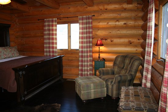 Nye, MT: Master suite offers king-sized bed, buffalo-hide rug, and oversized seating.