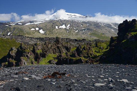 Hellnar, Iceland: Snaefellsjokull volcanon and glacier from the Djupalonssandur beach