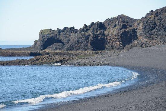 Hellnar, Iceland: Lava cliffs along Djupalonssandur beach. The trail to Dritvik continues beyond those cliffs.