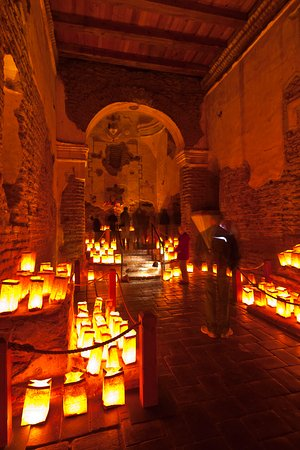 Interior of Tumacacori with luminarias.