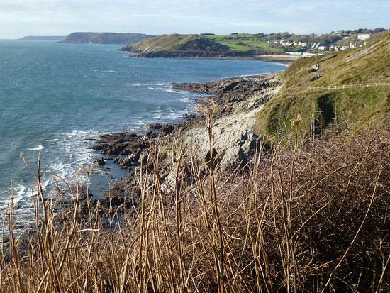 Forte's Ice Cream Parlour: About 10 minutes around the 1st headland from Fortes you see Langland Bay