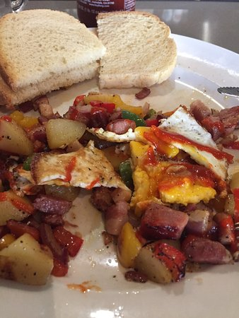 Campbell, CA: Pancetta hash with sunny side up egg and sriracha drizzled on top