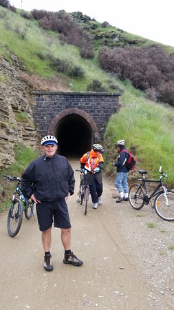 Clyde, New Zealand: With fellow cyclists after riding through a tunnel on the track