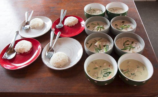 Maret, Thailand: Mild and creamy Tom Kah Gai together with hot and spicy Green Curry with rice.