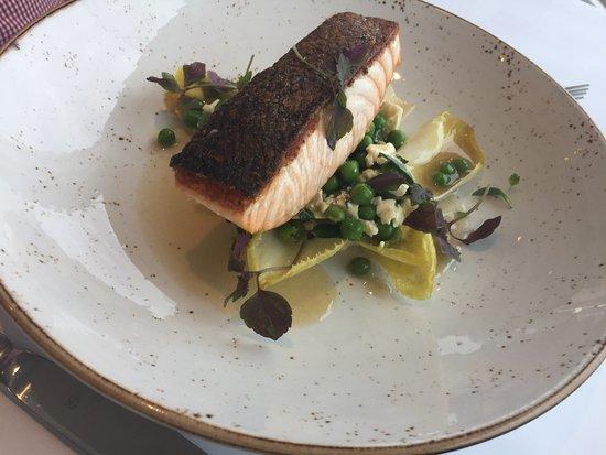 Cronulla, Australia: Crispy skin salmon with peas, feta, mint, wiltlof, crushed hazelnuts and sherry vinaigrette